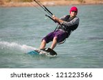 Kiteboarder enjoy surfing - stock photo