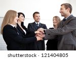 Group of business people holding hands - stock photo