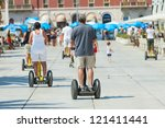 SPLIT, CROATIA - AUGUST 26, 2012: People on Segways on the waterfront in Split  on August 26, 2012 in Split, Croatia. Split is the second largest city in Croatia. - stock photo
