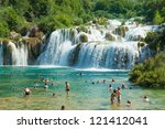 KRKA, CROATIA - JULY 28, 2012: People on the lake on July 28, 2012 in Krka, Croatia. The Krka National Park is one of eight national parks in Croatia. - stock photo