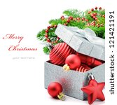 Christmas gift box with festive decorations isolated over white - stock photo