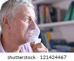 Close Up Of An Old Man Doing...