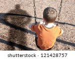 A Young Boy Is Sitting On A...