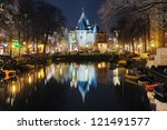AMSTERDAM - FEBRUARY 15: Evening view of The Waag (old city gate) on February 15, 2011 in Amsterdam, Netherlands. The Waag of 15th century is the oldest remaining non-religious building in the city. - stock photo