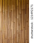 Bamboo sticks serving as background - stock photo