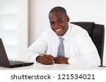happy african american businessman writing report - stock photo