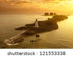 lighthouse and resort on nassau, bahamas at dawn - stock photo