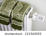 pair of green knitted gloves... | Shutterstock . vector #121565053