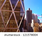 Modern steel and glass building in new york city with older buildings in the background shot from the 22nd floor of an adjacent building - stock photo