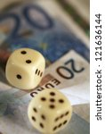 Two dices on money background - business concept. Very shallow focus. - stock photo