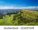 Edinburgh and green hills in summer - stock photo