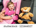 baby in a safety car seat.... | Shutterstock . vector #121666027