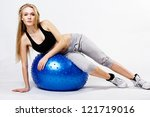Young  woman with fit-ball, isolated over white background - stock photo