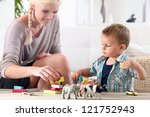 mother playing with child | Shutterstock . vector #121752943