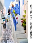 Beautiful whitewashed street in the old town of Mykonos, Greece - stock photo