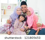 Southeast Asian family quality time at home. Muslim family living lifestyle. - stock photo