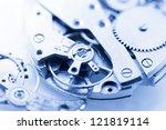 Close up shot of watch mechanism and with its spare parts - stock photo