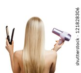 Blonde hair and hairdresser's tools - stock photo