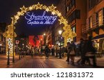 STRASBOURG, FRANCE, DEC 12: People walking on the street during the festive Christmas illumination on December 12 2012 in Strasbourg. In winter here is held a famous Christmas market and illumination. - stock photo