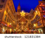 STRASBOURG, FRANCE, DEC 12:People on the street during the festive Christmas illumination on December 12 2012 in Strasbourg. In winter in Strasbourg is held a famous Christmas market and illumination. - stock photo