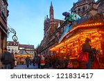 STRASBOURG, FRANCE, DEC 12:People walking among street stands during the winter illumination on December 12 2012 in Strasbourg.In winter here is held a famous Christmas market and illumination. - stock photo