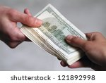 Male hands giving dollars.Shallow focus. - stock photo