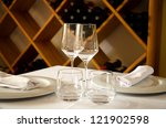 Restaurant table with dish, glasses and cutlery - stock photo