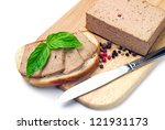 Fresh pate on bread on the cutting board - stock photo