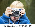 Young Photographer  Holding A...