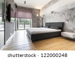 Modern bedroom with wooden floor and big window - stock photo
