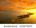 nassau bahamas and lighthouse at dawn - stock photo