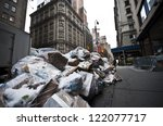 Garbage bags on the sidewalk in New York City, USA - stock photo