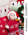 baby in a santa hat | Shutterstock . vector #122100073
