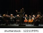 "DNEPROPETROVSK, UKRAINE - DEC.17: ""Four seasons"" Chamber Orchestra - main conductor Druzelub Yanakiev perform music of  Mozart, Elgar, Brittain, Dvorak on Dec. 17, 2012 in Dnepropetrovsk, Ukraine - stock photo"