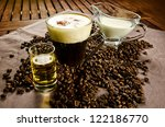 Warm Irish Coffee with coffee beans, whiskey and cream - stock photo