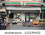BANGKOK - NOV 11: Exterior of a 7-Eleven store on a road in Banglampoo district on Nov 11, 2012 in Bangkok, Thailand. There are 6300 7-Eleven stores in Thailand, the third highest number in the world. - stock photo