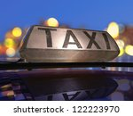 Taxi light on the roof of the car, at the city at night. - stock photo