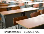 Empty Classroom With Chairs An...