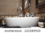 Close-up photo of chrome sink with taps - stock photo