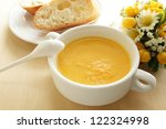 french cuisine, bread and carrot soup for gourmet breakfast image - stock photo
