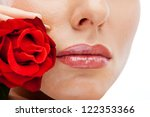 Young beauty model with rose near lips - stock photo