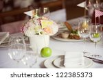 decorated wedding table in the... | Shutterstock . vector #122385373