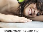 A happy content young woman outside. - stock photo