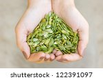 Pumpkin Seeds' Kernel In Woman...