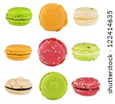 traditional french colorful macarons folded in pyramid on an isolated white background - stock photo