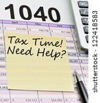 Tax form 1040, spread sheet with pen, calculator and sticker. - stock photo