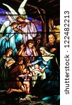 Christmas stained glass window depicting birth of Jesus Christ - stock photo