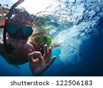 Young Active Couple Snorkeling...
