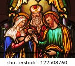 Stained glass window depicting betrothal of Mary and Joseph - stock photo