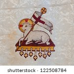 Lamb of God Easter symbol embroidered on old church vestment - stock photo